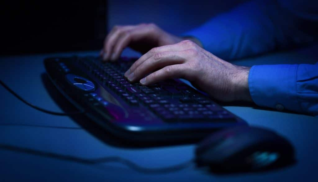 Hacker hacking the server in the dark room