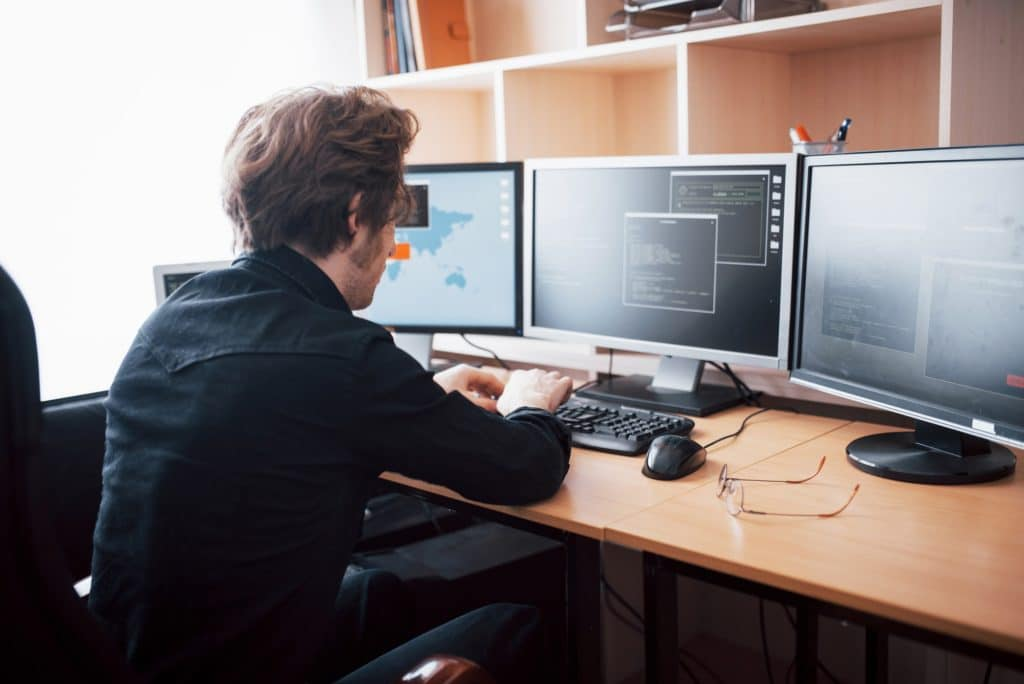 The young dangerous hacker breaks down government services by downloading sensitive data